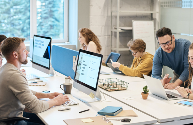 several people working on computers in open office